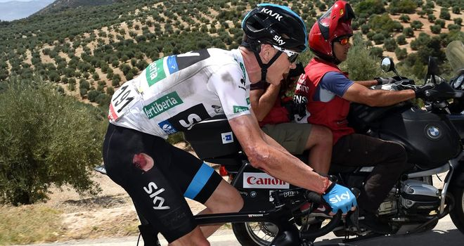 Chris Froome suffered cuts to his arm, hip and knee in the crash