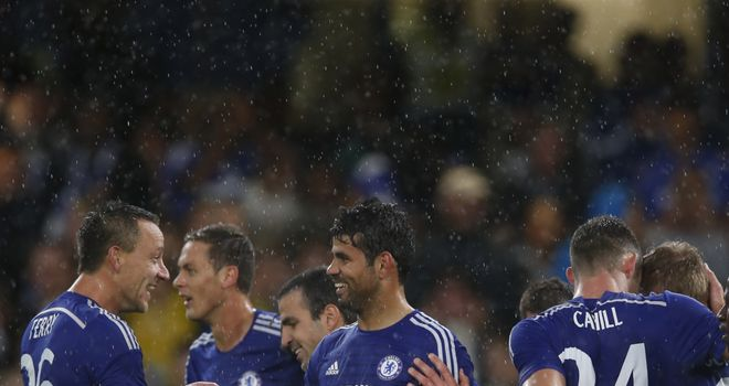 Diego Costa: Celebrates his second goal with his team-mates