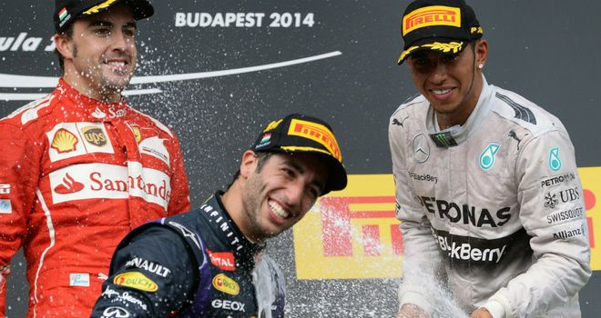Daniel Ricciardo celebrates with Fernando Alonso and Lewis Hamilton on the Hungarian GP podium