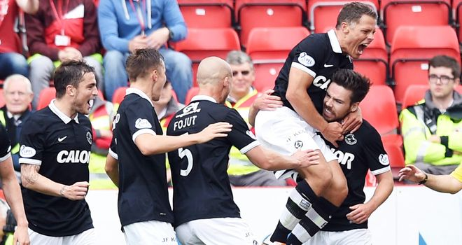 Ryan Dow (far right) celebrates his opening goal at Pittodrie
