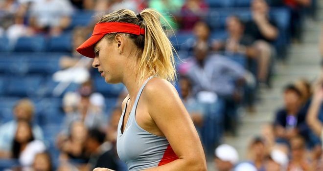 Maria Sharapova celebrates defeating Alexandra Dulgheru