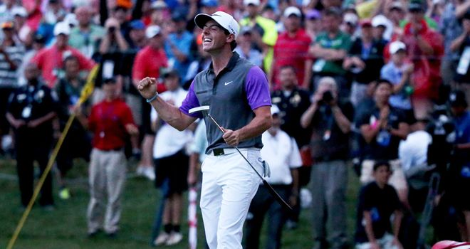 Rory McIlroy celebrates on the 18th green