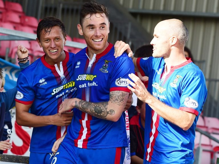 Greg Tansey (centre) celebrates for Inverness
