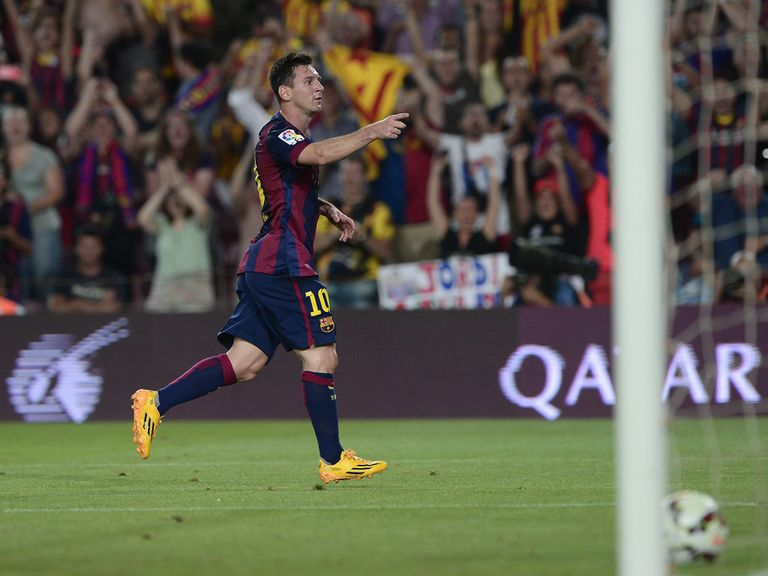 Lionel Messi celebrates his second goal of the night