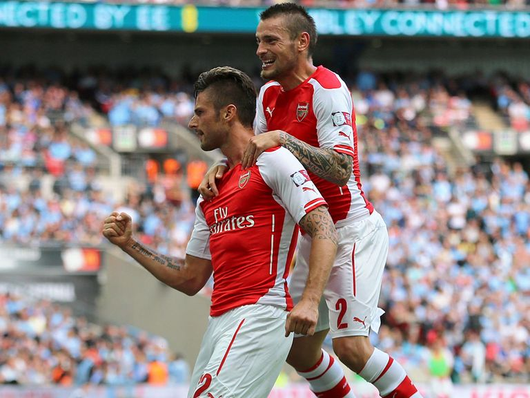 Olivier Giroud and Mathieu Debuchy celebrate during the Community Shield