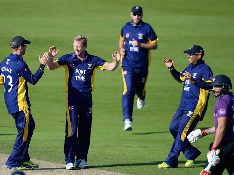Paul Collingwood of Durham celebrates with his teammates
