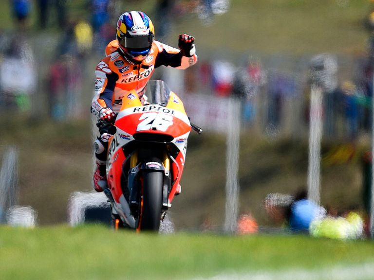 Dani Pedrosa celebrates after winning the MotoGP race at the Brno Circuit