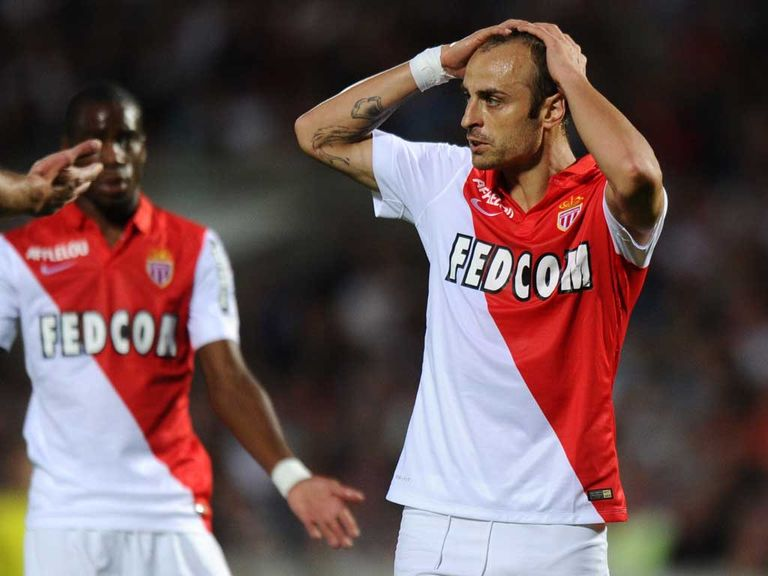 Forward Dimitar Berbatov reacts after Monaco's hammering on Sunday