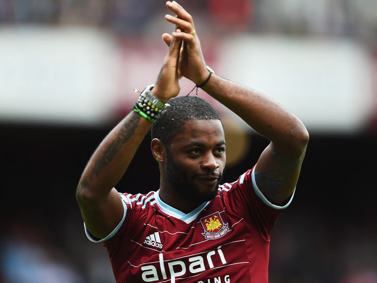 Alex Song of West Ham United applauds the fans as he joins the club on loan