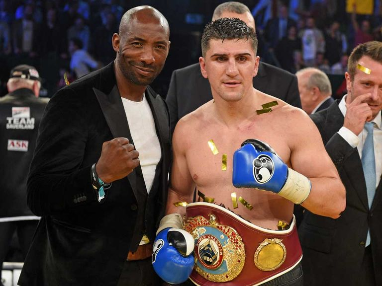 Marco Huck celebrates with Johnny Nelson after his win