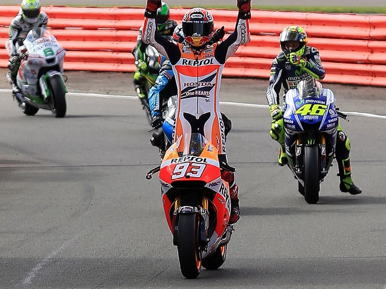 Marc Marquez celebrates his victory at Silverstone