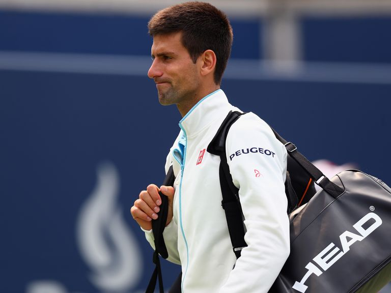 Novak Djokovic walks off the court after a loss at the Rogers Cup