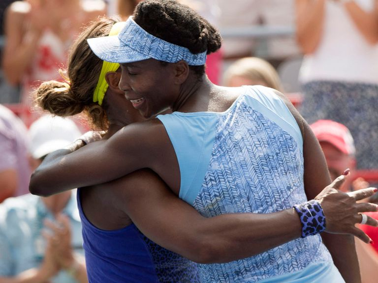 Venus Williams hugs her sister Serena after beating her at the Rogers Cup