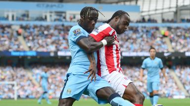 Manchester City defender Bacary Sagna challenges Stoke's Victor Moses.