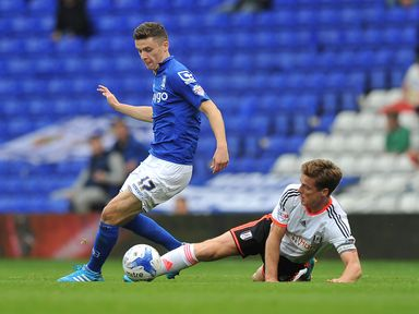 Callum Reilly is tackled by Scott Parker