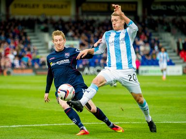 Michael Gardyne goes up against James McAlister