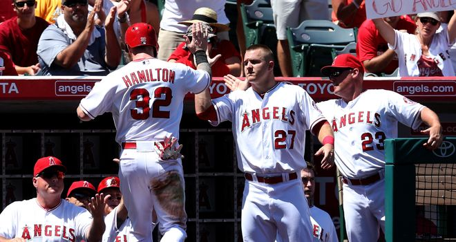 Josh Hamilton is congratulated by Mike Trout as the Los Angeles Angels beat the Oakland Athletics