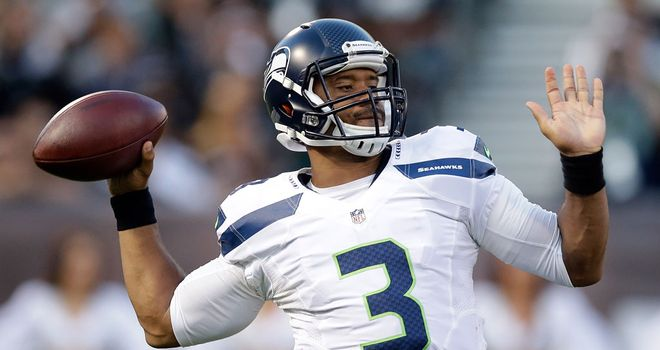 Seattle's Russell Wilson in action against the Oakland Raiders at O.co Coliseum