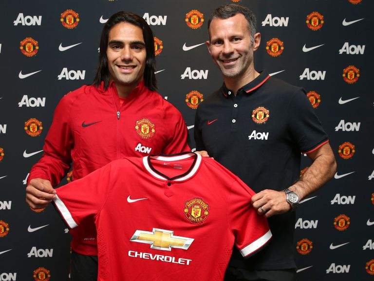Manchester United striker Radamel Falcao is welcomed by Ryan Giggs
