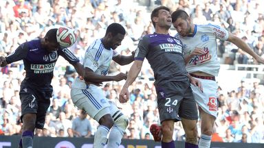 Marseille forward Andre-Pierre Gignac heads at goal
