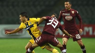 Bruno Peres (R) of Torino FC competes with Jose Mauri of Parma FC