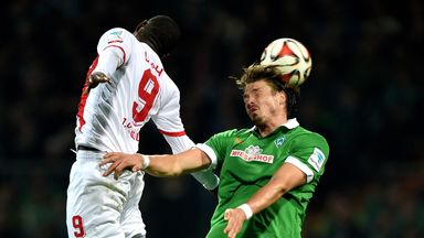 Anthony Ujah of Cologne and Sebastian Prodl of Werder Bremen compete for a header