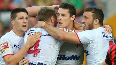 Joel Tomkins is mobbed by his England team-mates after scoring a crucial second-half try