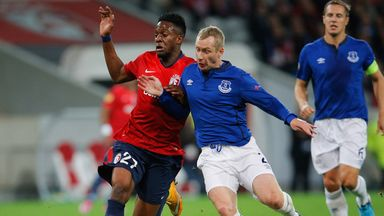 Divock Origi (left) battles for possession with Tony Hibbert