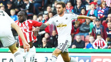 Stoke's Victor Moses (centre) goes down in the Swansea penalty area