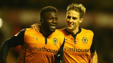 Bakary Sako celebrates with Dave Edwards after scoring a first-half penalty