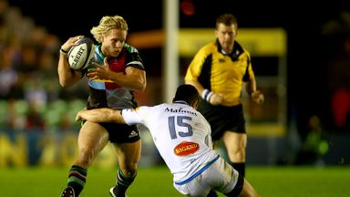 Matt Hopper of Harlequins is tackled by Geoffrey Palis