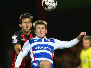 Simon Cox of Reading is put under pressure