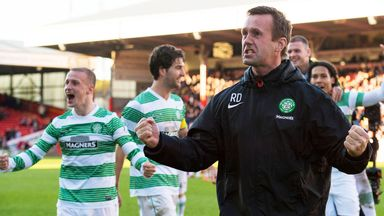 Celtic boss Ronny Deila celebrates with players after Scottish Premiership victory