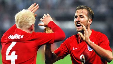 Will Hughes and Harry Kane celebrate an England U21 goal during their play-off against Croatia
