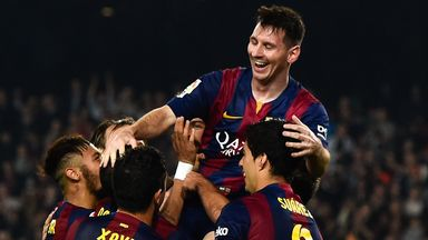 Lionel Messi celebrates after scoring his team's fourth goal against Sevilla