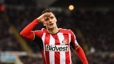 Adam Johnson celebrates scoring the winner against Newcastle