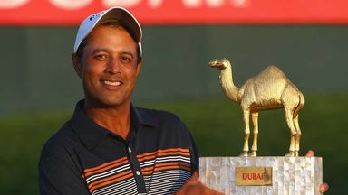 Arjun Atwal proudly displays his Dubai Open trophy