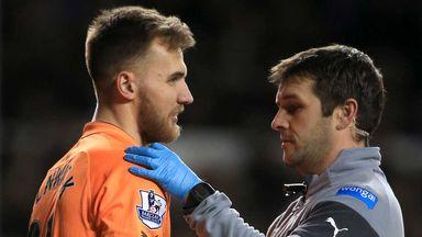 Jak Alnwick: Newcastle goalkeeper receives treatment on his shoulder injury at Tottenham