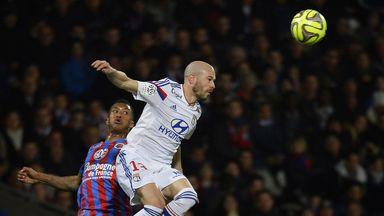 Lyon defender Christophe Jallet wins a header