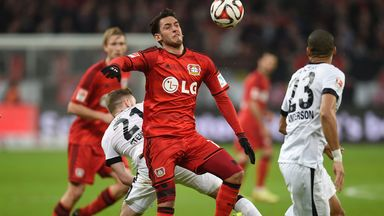 Marc Stendera is held off by Hakan Calhanoglu