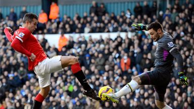 Tottenham goalkeeper Hugo Lloris saves from Robin van Persie.