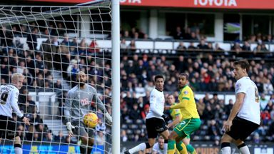 Derby County and Norwich City players look on as Steven Whittaker (in background) scores late equaliser