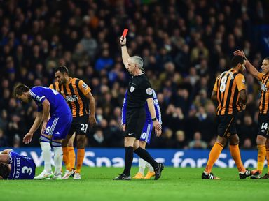 Referee Chris Foy shows a red card to Hull's Tom Huddlestoneafter a challenge on Filipe Luis
