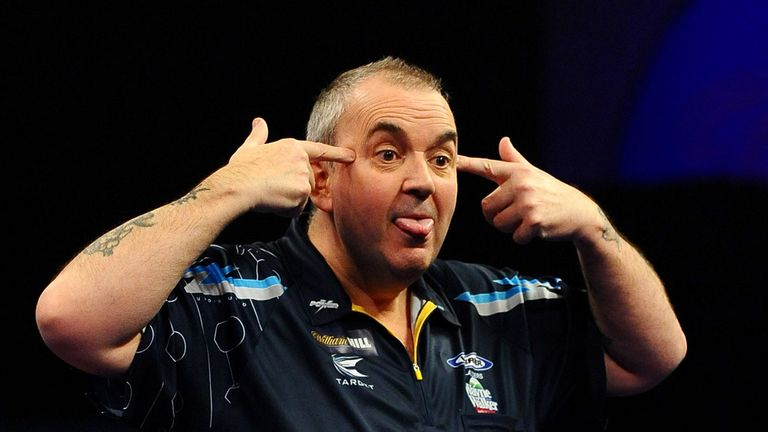 Phil Taylor: Faces his younger rival in Nottingham tonight