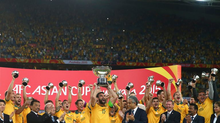 Mile Jedinak: Lifts the Asian Cup trophy for Australia