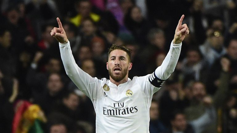 Real Madrid's defender Sergio Ramos celebrates after scoring against Atletico Madrid