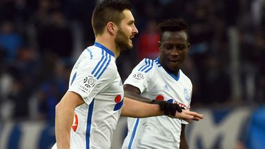 Marseille's forward Andre-Pierre Gignac is congratulated by defender Benjamin Mendy