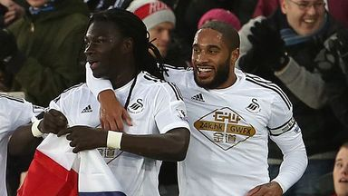 Bafetimbi Gomis and Ashley Williams following Swansea
