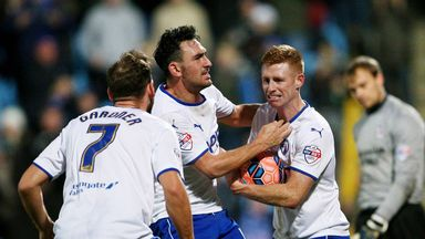 Eoin Doyle (R) of Chesterfield is congratulated by his teammates