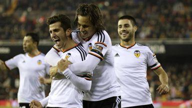 Valencia's defender Jose Gaya (left) celebrates a goal.